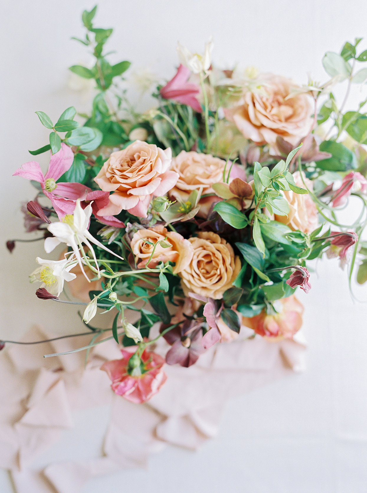 thuy kahn wedding floral bouquet in warm colors