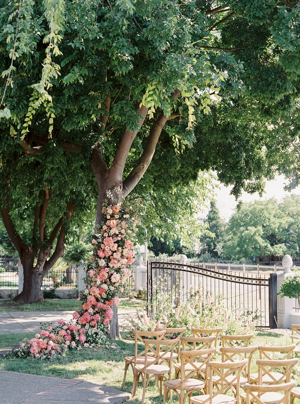 thuy kahn wedding ceremony space floral garland
