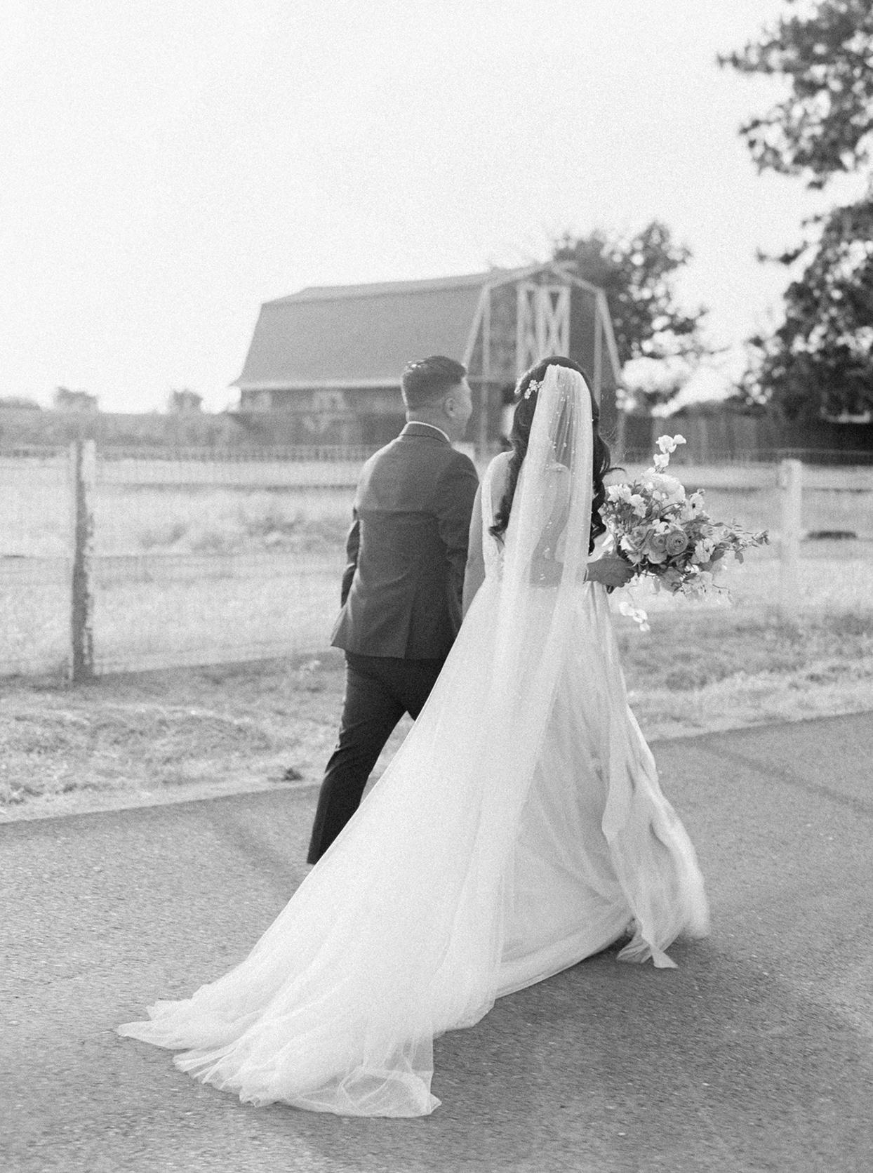 thuy kahn wedding couple walking down road