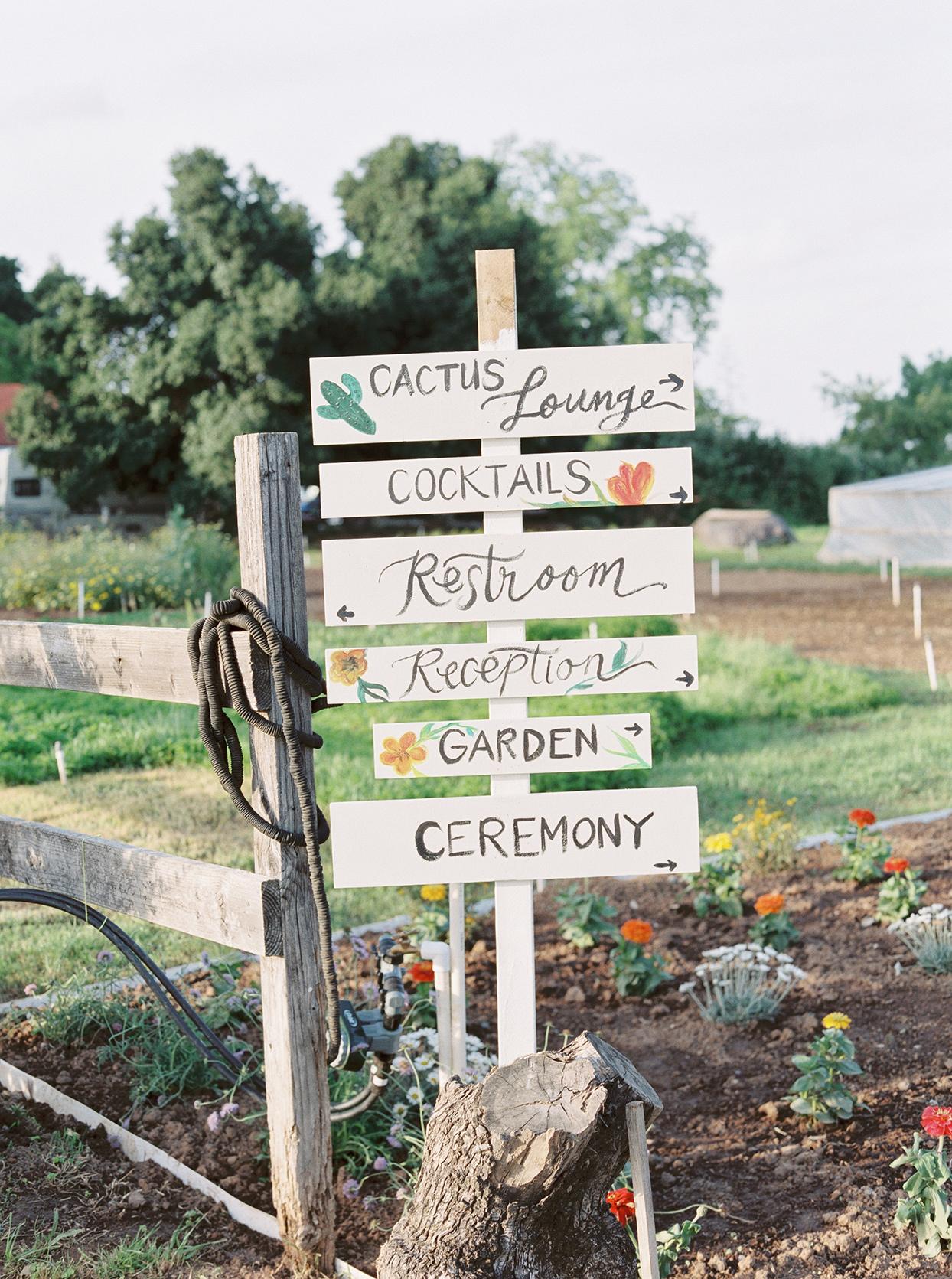 thuy kahn wedding wooden sign in garden