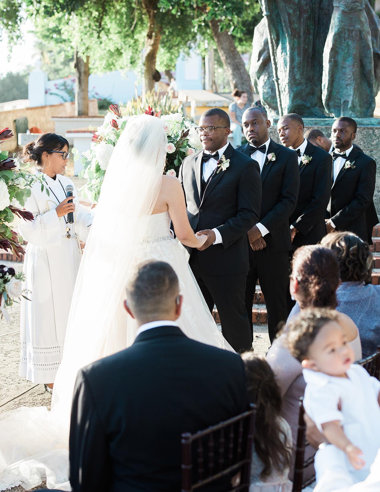 victoria tk wedding ceremony holding hands