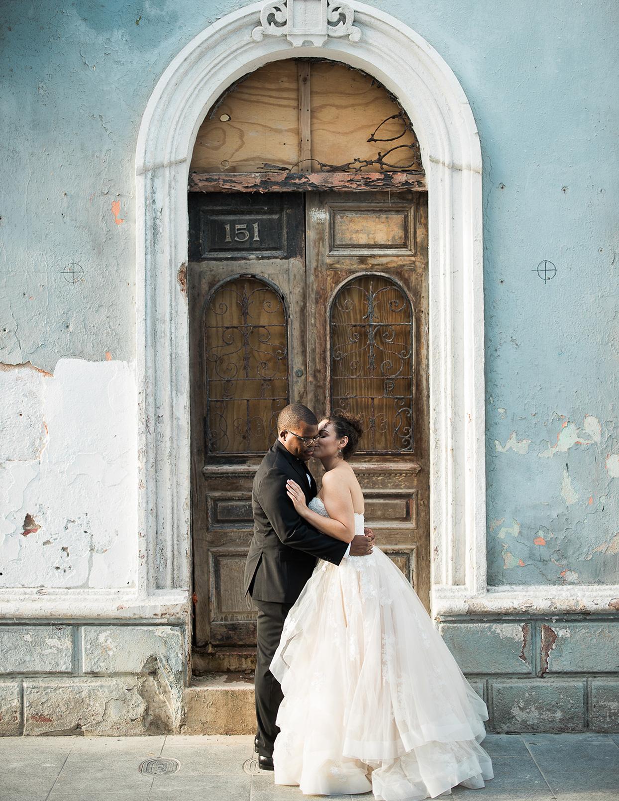 victoria tk wedding couple in front of door