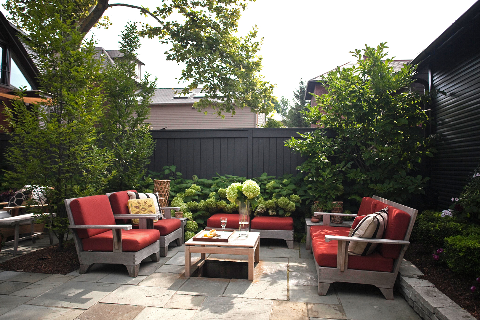 patio with dark red furniture and black fence