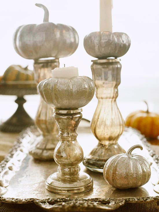 Silver pumpkins on crystal vases