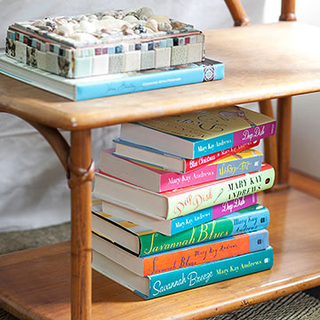 Colorful books on side table