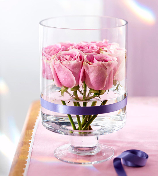 Vase wrapped with ribbon for centerpiece