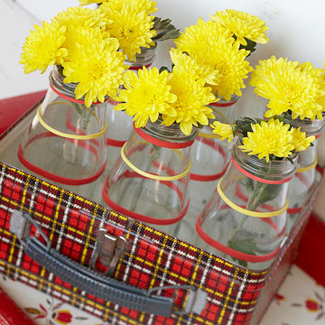 Mums in glass jars in a lunch box