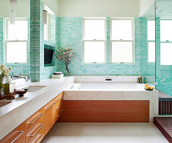 Bathroom with teal blue tile walls