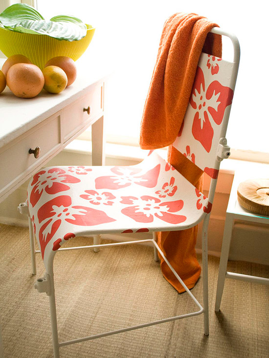 Metal chair with hibiscus blooms