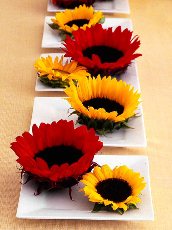 Large red and yellow sunflowers on tables