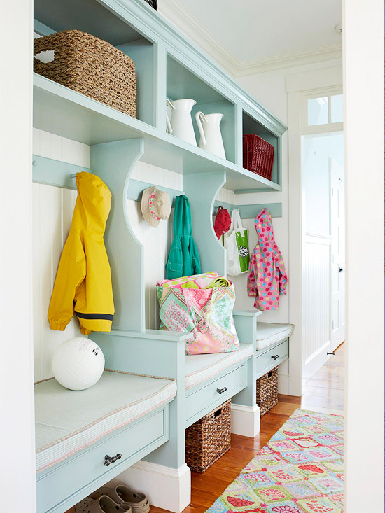 Individual cubbies along wall of mudroom