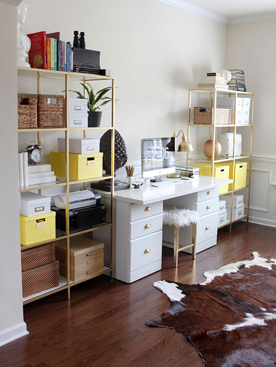 Gold-painted bookcases
