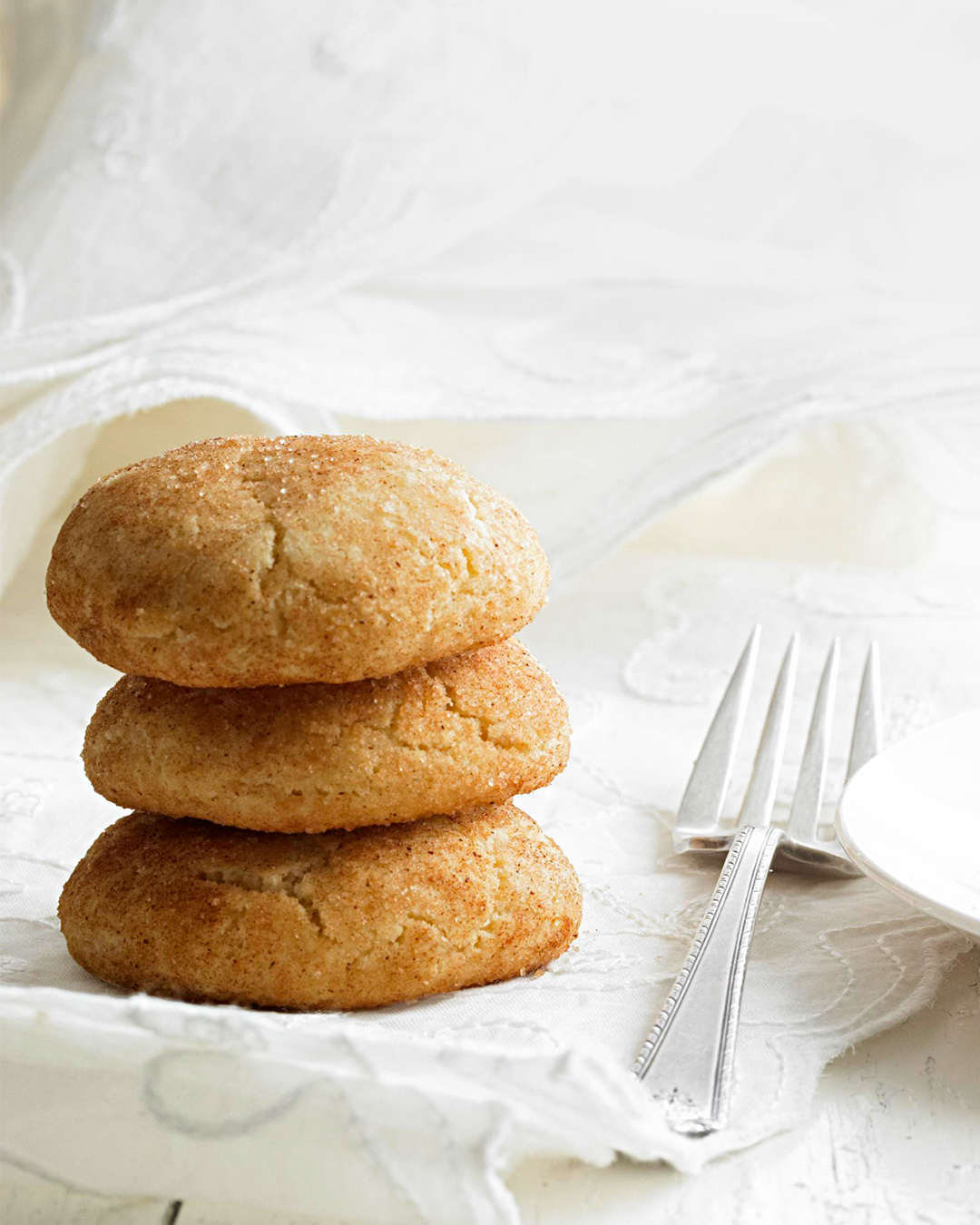 Classic Snickerdoodles in stack with fork