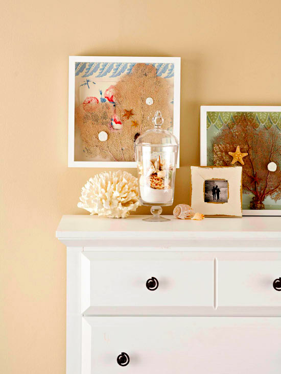 White dresser with beach shadow box