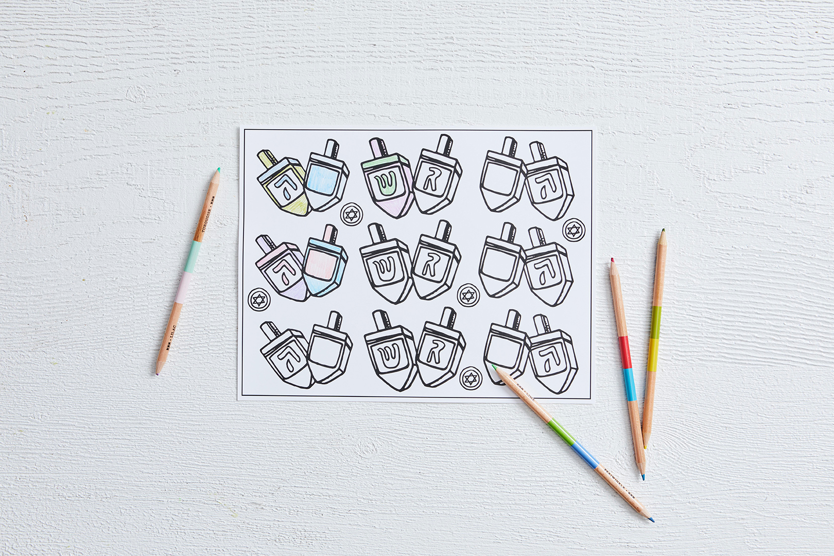 coloring page dreidels for hanukkah with colored pencils