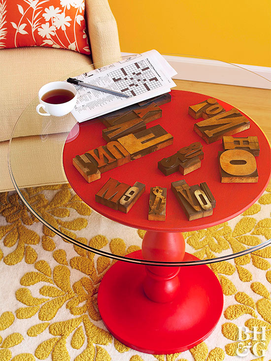 glass side table with red base