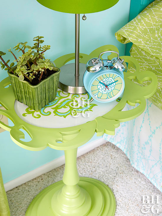 green candlestick bedside table