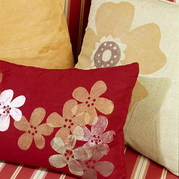Large pillows with painted flower motifs