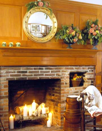 round mirror above fireplace