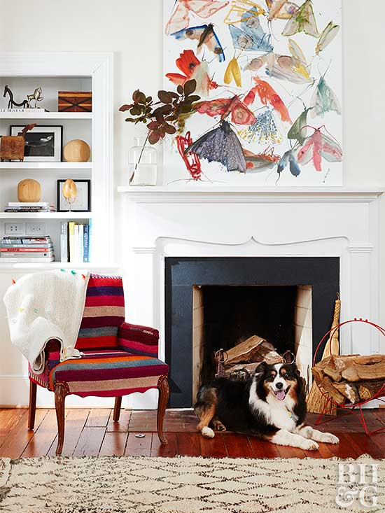 art in living room with fireplace