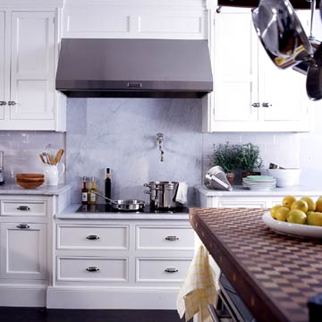 White Cabinets With Grey Stove Hood