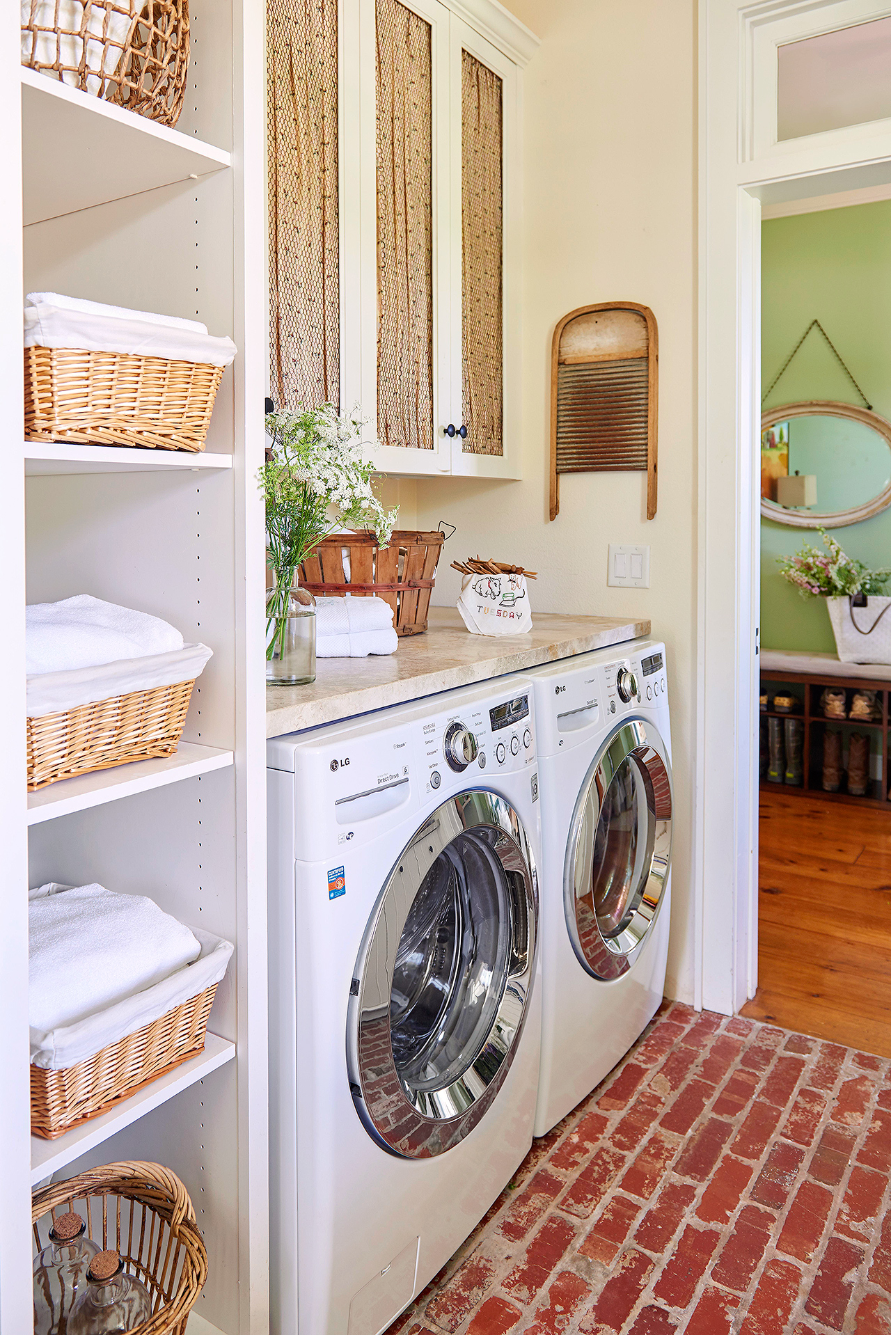 traditional laundry room with side-by-side appliances