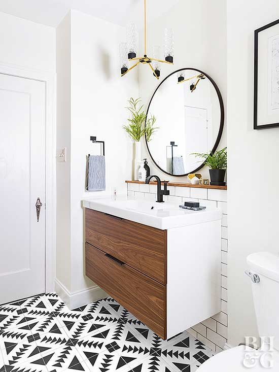 modern bathroom with round mirror and single sink cabinet