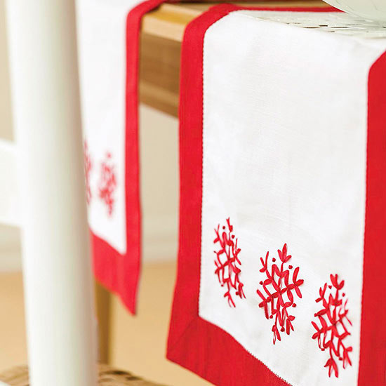Red and white snowflake table runner