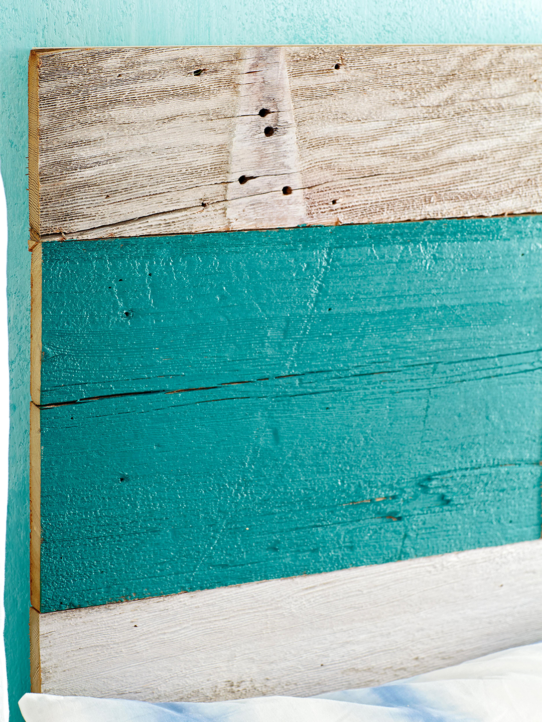 Barn-Board Headboard against teal wall