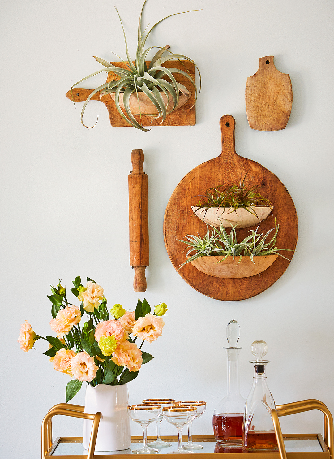 planters made from vintage breadboards above bar cart