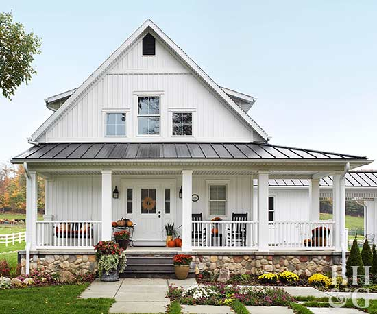 white farmhouse with wrap-around porch