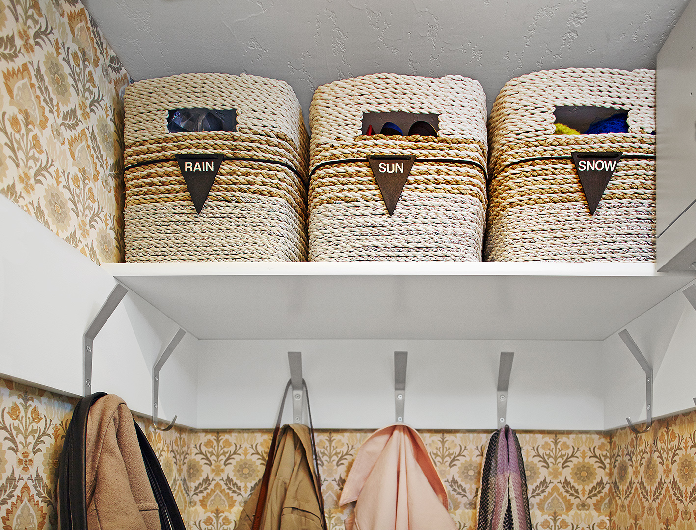 woven labeled baskets on high closet shelf for seasonal items