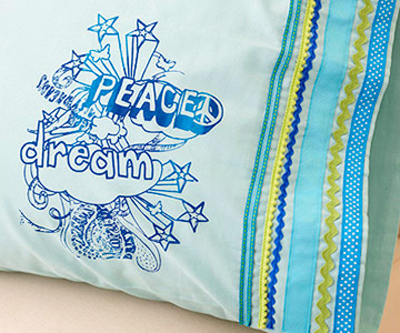 Screen-printed pillowcase with ribbons