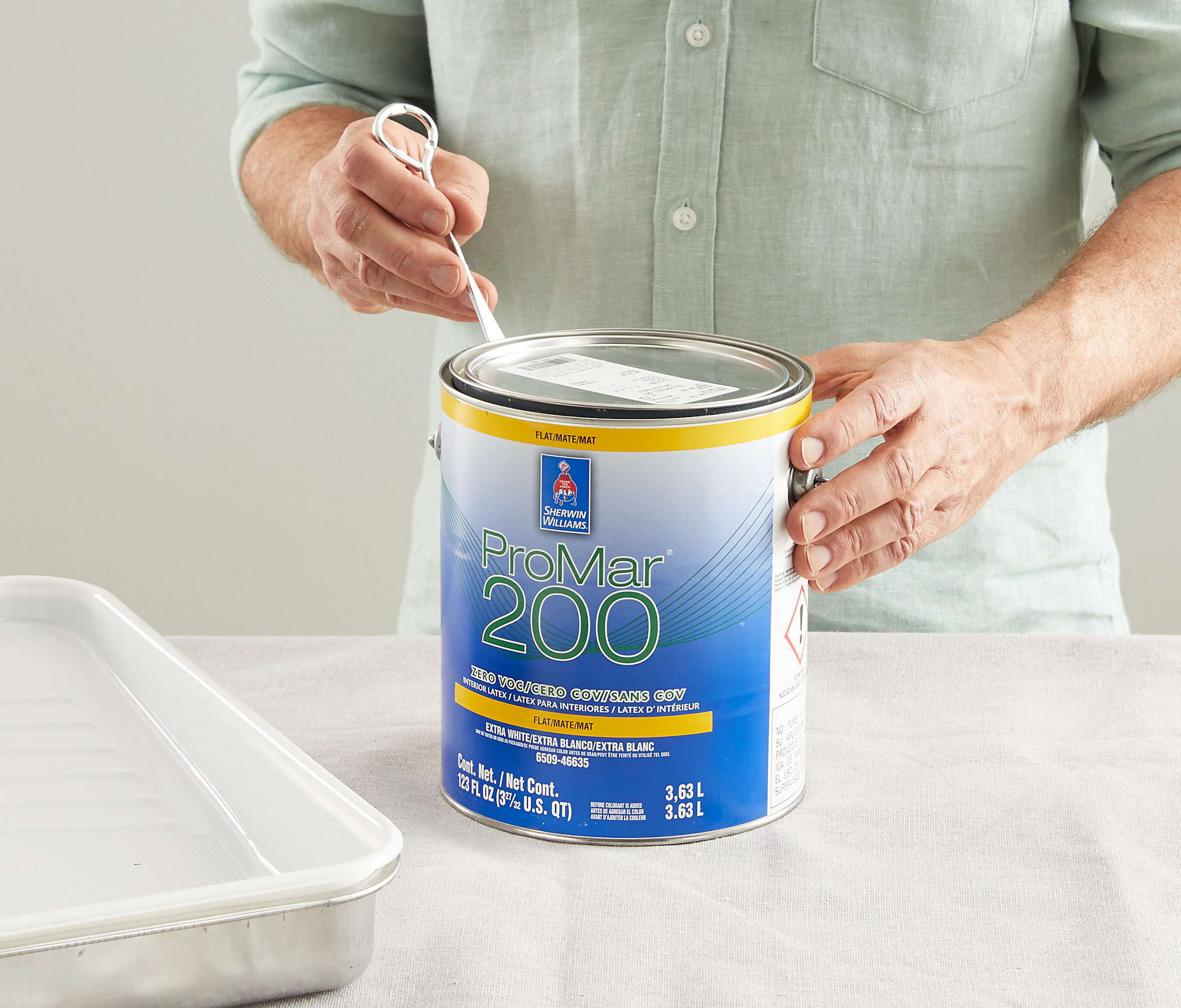 loosening paint can lid with tool