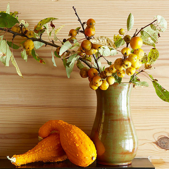Mantel with gourd and fall accessories