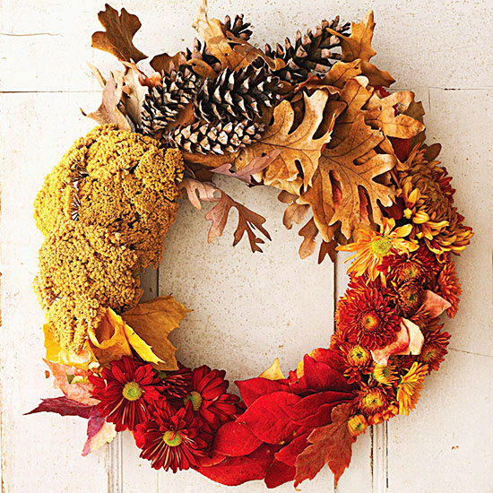 Fall wreath made of flowers, leaves, and pinecones