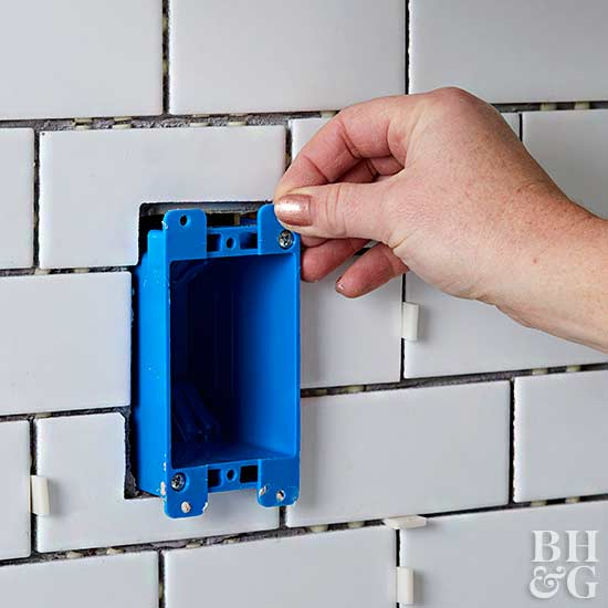 placing electrical box in tile