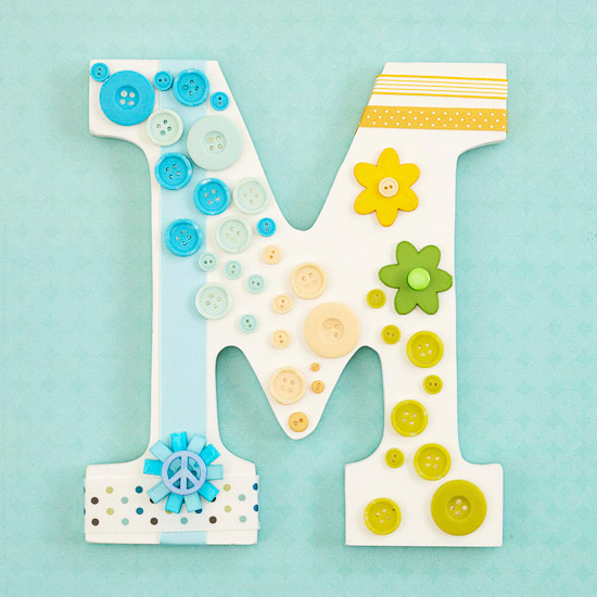 Wooden letter embellished with leftover scrapbooking supplies