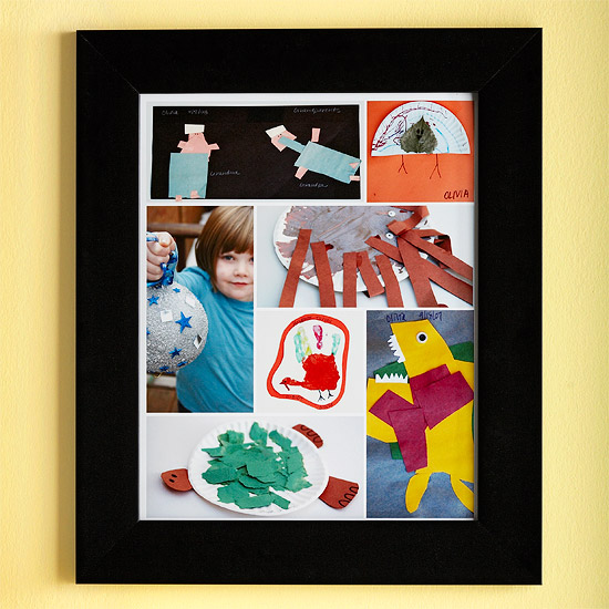 Black frame surrounds kid¿s art projects.