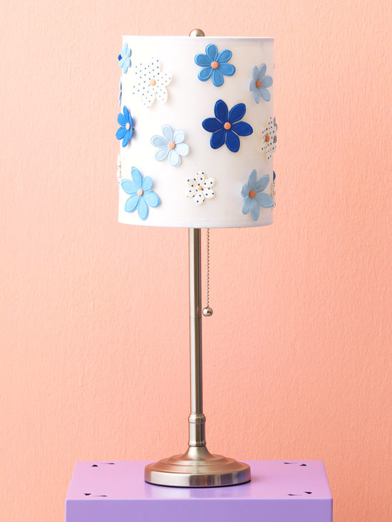 Lampshade covered in scrapbooking flower accents, adhered with pink brads and hot glue