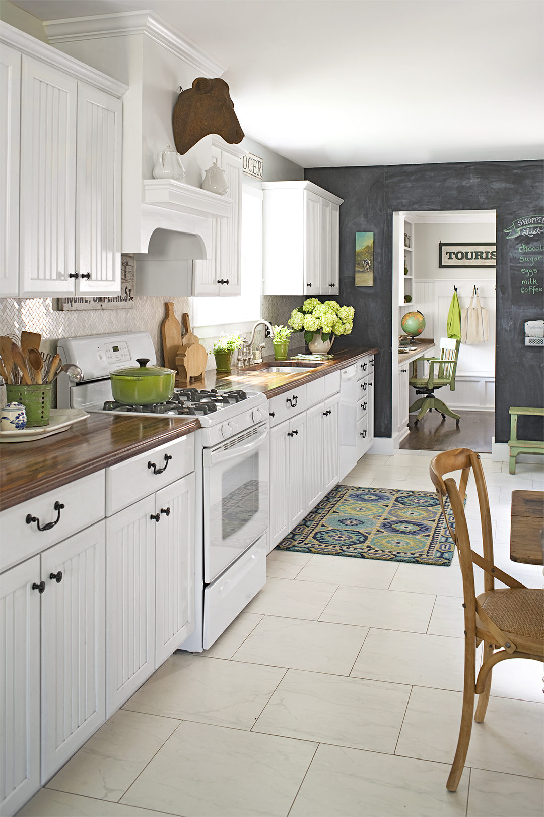 white kitchen with bead board cabinets and wooden countertops