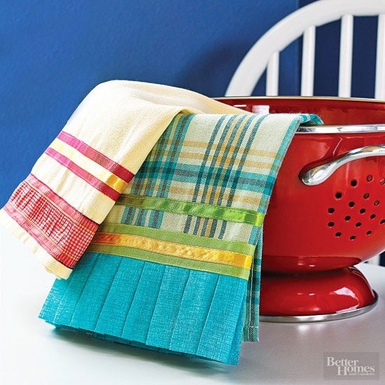 Plain tea towels embellished with ruffles and ribbon