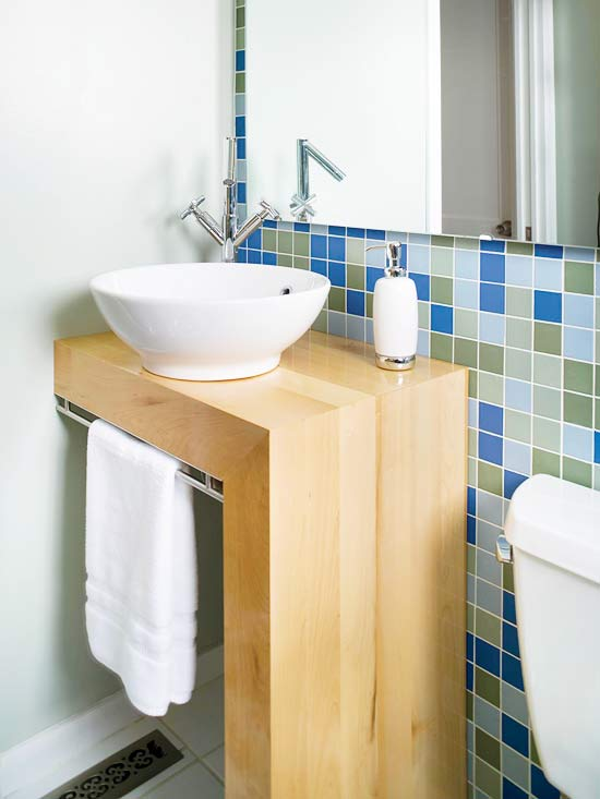 Blue/green tiles behind white sink