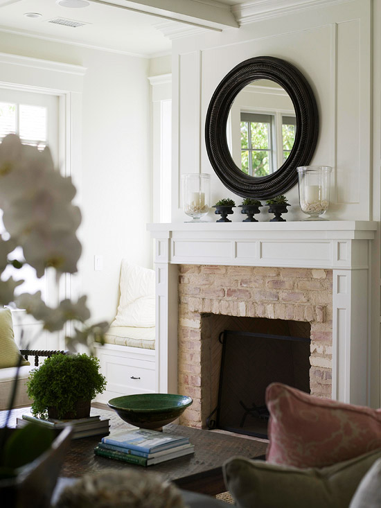 Simple white fireplace with brick