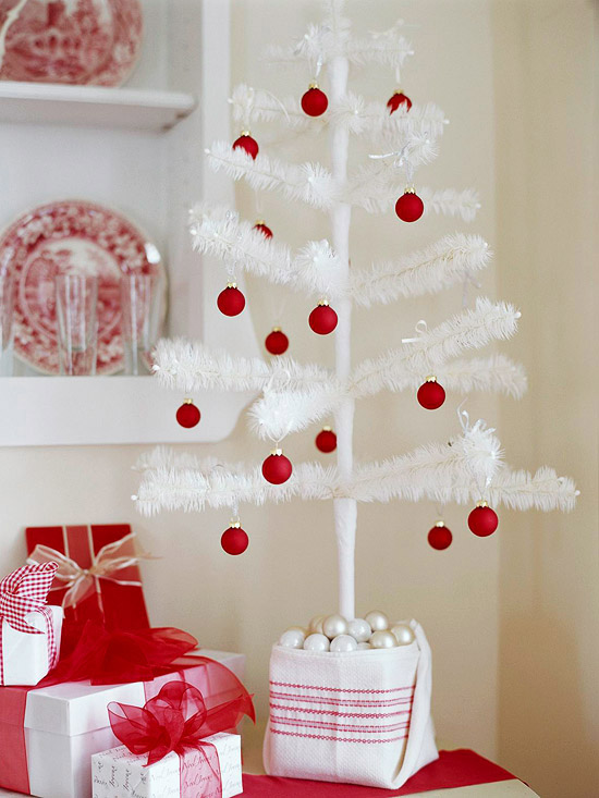 fake white Christmas tree with red balls