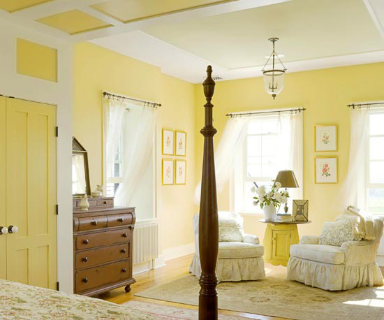 yellow bedroom sitting area