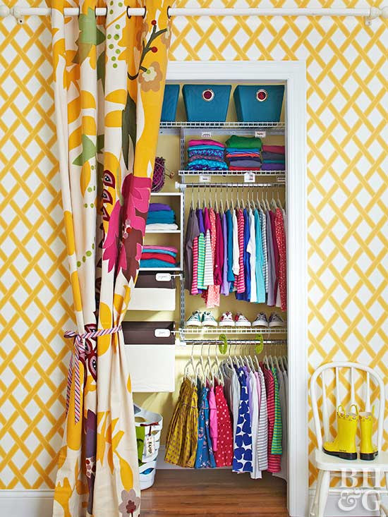 yellow room with closet and curtain