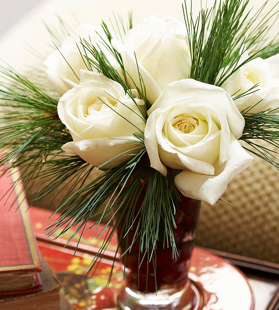 White roses and pine flower arrangement