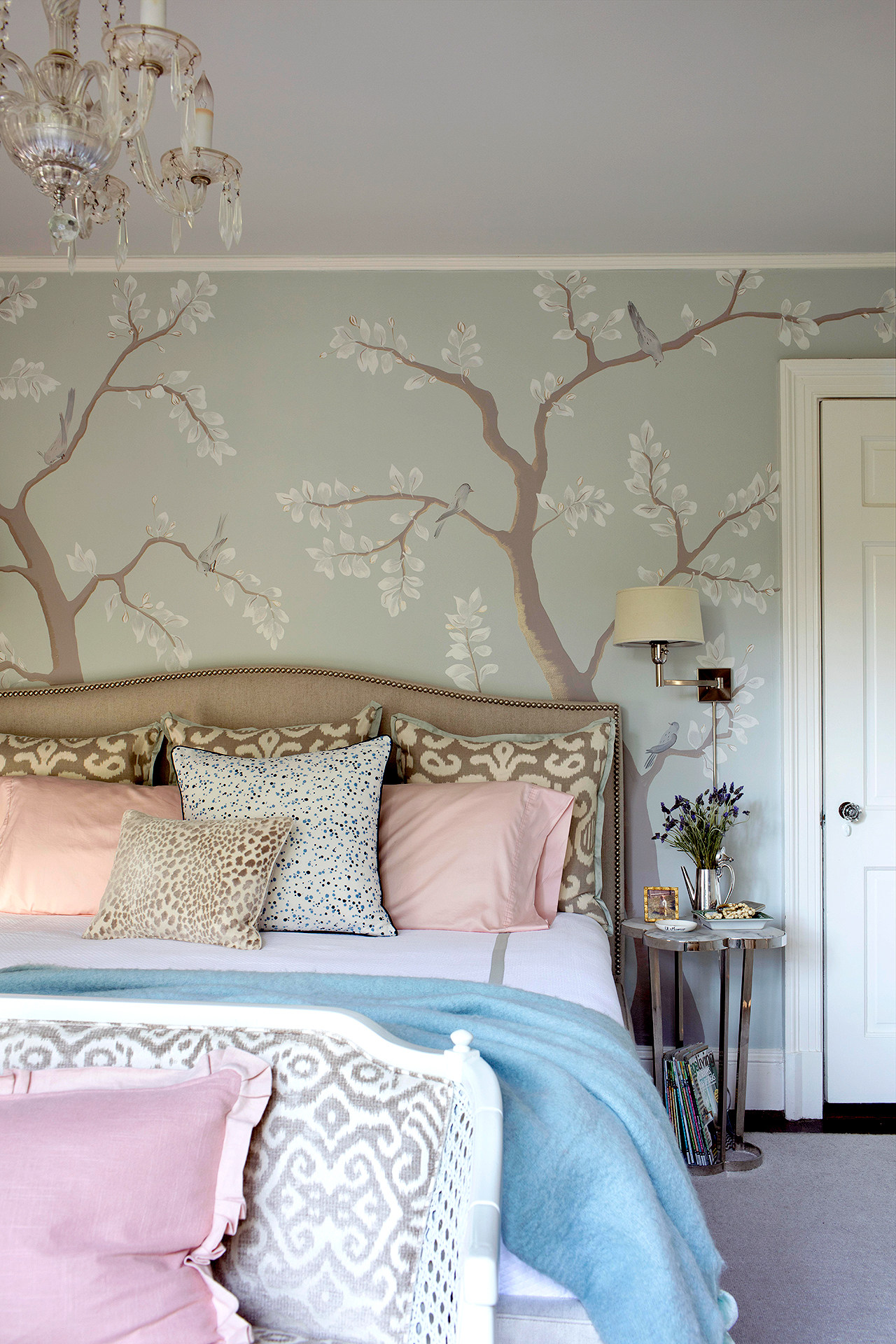 master bedroom with soft colors and cherry tree