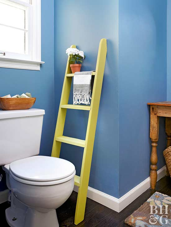 blue bathroom, yellow ladder, ladder